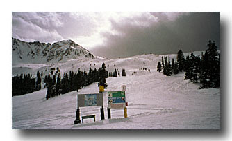 End of lower chair lift, transition to upper basin on the left